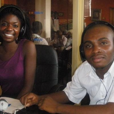 A journalism intern in Ghana with a supervisor